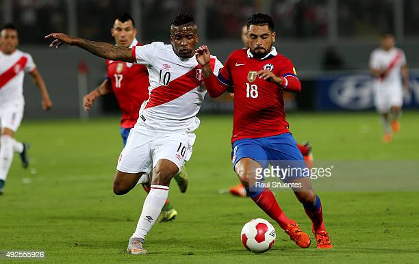 Jefferson Farfan of Peru struggles for the ball with Gonzalo Jara of Chile during a match between Peru and Chile as part of FIFA 2018 World Cup...