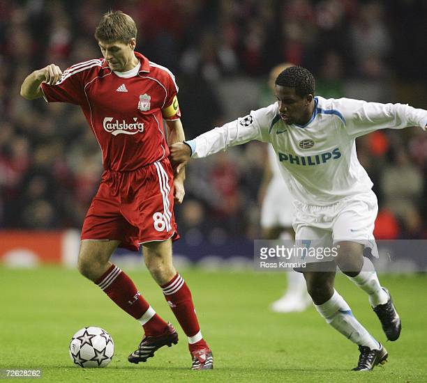 Jefferson Farfan of PSV Eindhoven holds on to Steven Gerrard of Liverpool during the UEFA Champions League Group C match between Liverpool and PSV...