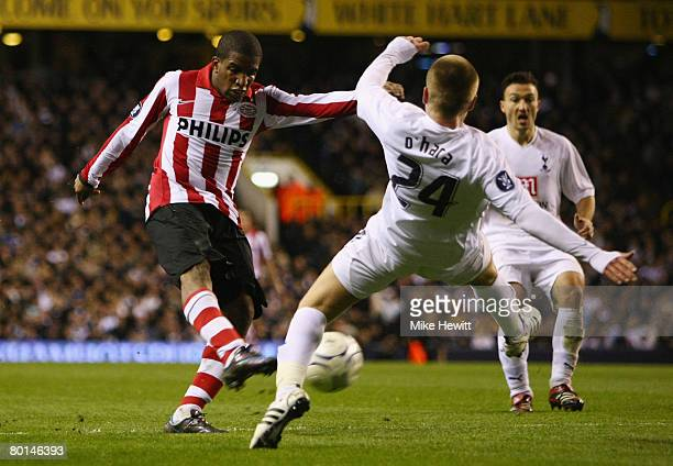 Jefferson Farfan of PSV shoots past the outstretched Jamie O'Hara of Tottenham during the UEFA Cup round of 16 first leg match between Tottenham...