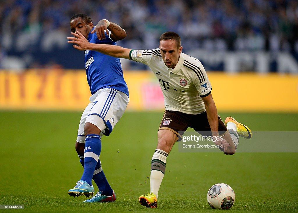 Jefferson Farfan of Schalke 04 challenges Franck Ribery of Bayern Muenchen during the Bundesliga match between FC Schalke 04 and FC Bayern Muenchen...
