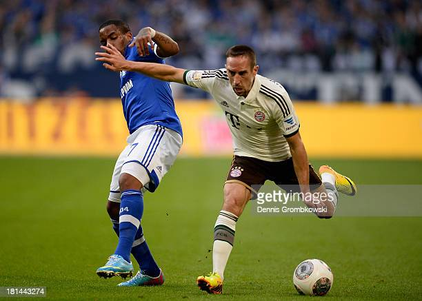 Jefferson Farfan of Schalke 04 challenges Franck Ribery of Bayern Muenchen during the Bundesliga match between FC Schalke 04 and FC Bayern Muenchen...