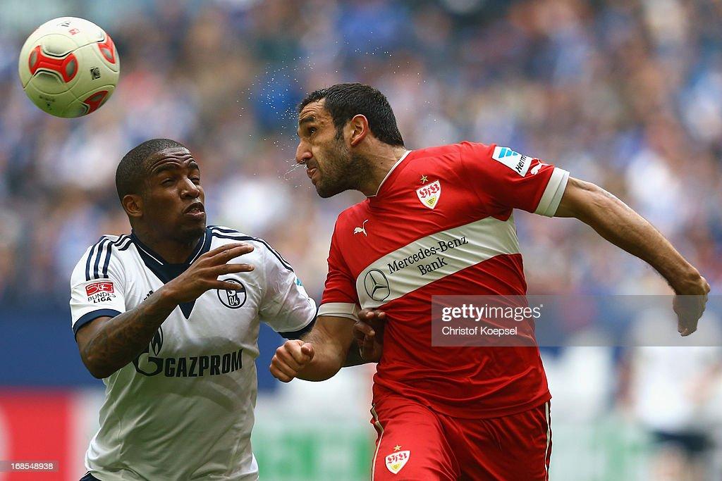 Jefferson Farfan of Schalke and Christian Molinaro of Stuttgart go up for a head during the Bundesliga match between FC Schalke 04 and VfB Stuttgart...