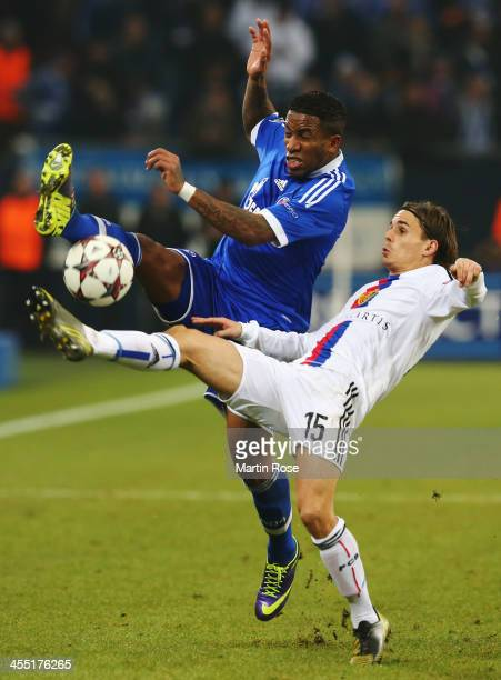 Jefferson Farfan of Schalke and Kay Voser of Basel challenge for the ball during the UEFA Champions League Group E match between FC Schalke 04 and FC...
