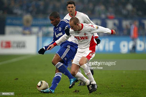 Jefferson Farfan of Schalke and Miso Brecko of Koeln battle for the ball during the Bundesliga match between FC Schalke 04 and 1 FC Koeln at the...