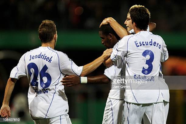 Jefferson Farfan of Schalke celebrates his team's first goal with team mates Erik Jendrisek Sergio Escudero and Ivan Rakitic during the DFB Cup first...
