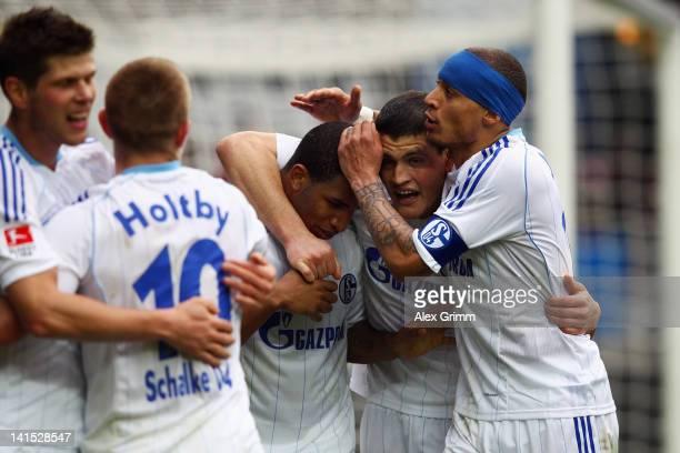 Jefferson Farfan of Schalke celebrates his team's fourth goal with team mates KlaasJan Huntelaar Lewis Holtby Kyriakos Papadopoulos and Jermaine...