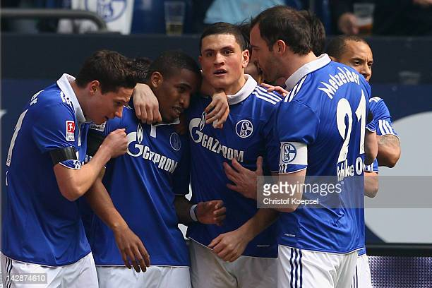 Jefferson Farfan of Schalke celebrates the first goal with Julnian Draxler Kyriakos Papadopoulos and Christoph Metzelder of Schalke during the...