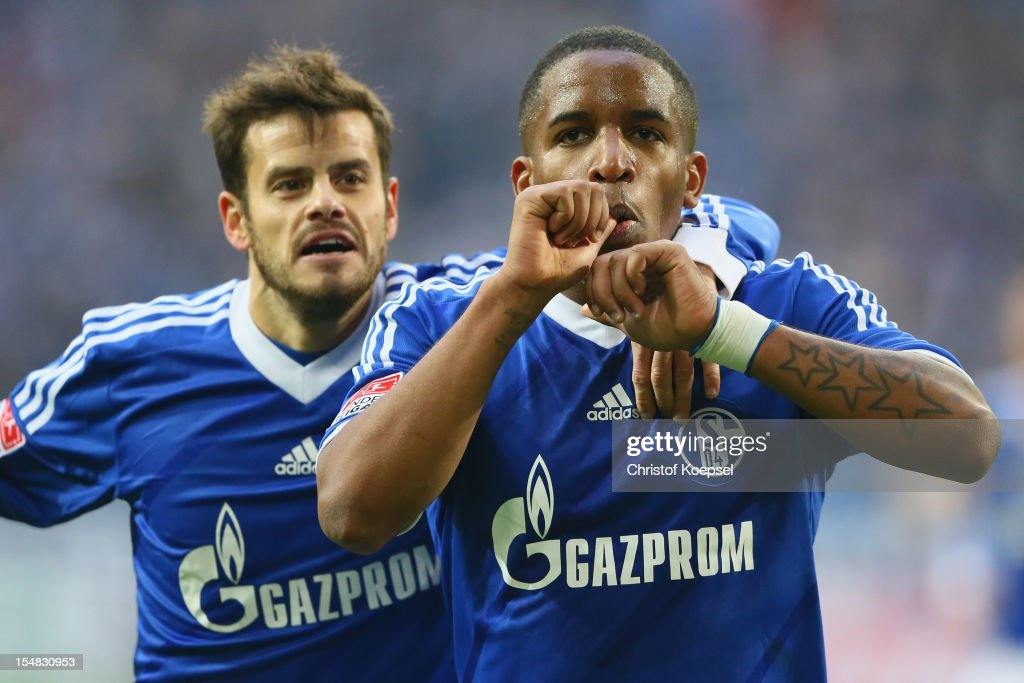 Jefferson Farfan of Schalke celebrates the first goal with Tranquillo Barnetta of Schalke during the Bundesliga match between FC Schalke 04 and 1 FC...
