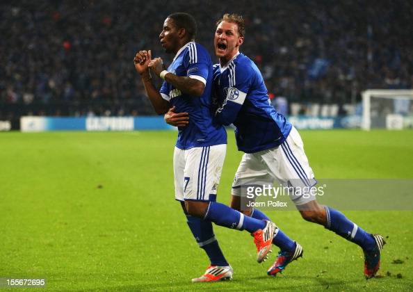 Jefferson Farfan of Schalke celebrates with his team mate Benedikt Hoewedes after scoring his team's second goal during the UEFA Champions League...