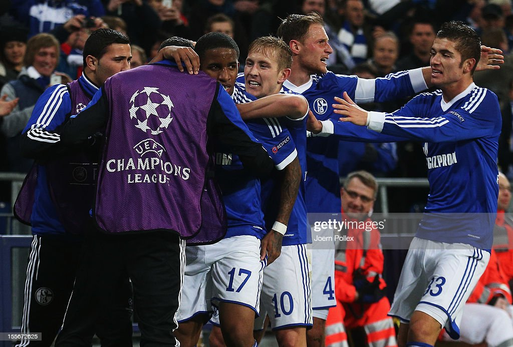 Jefferson Farfan (3rd L) of Schalke celebrates with his team mates after scoring his team's second goal during the UEFA Champions League group B match between FC Schalke 04 and Arsenal FC at Veltins-Arena on November 6, 2012 in Gelsenkirchen, Germany.