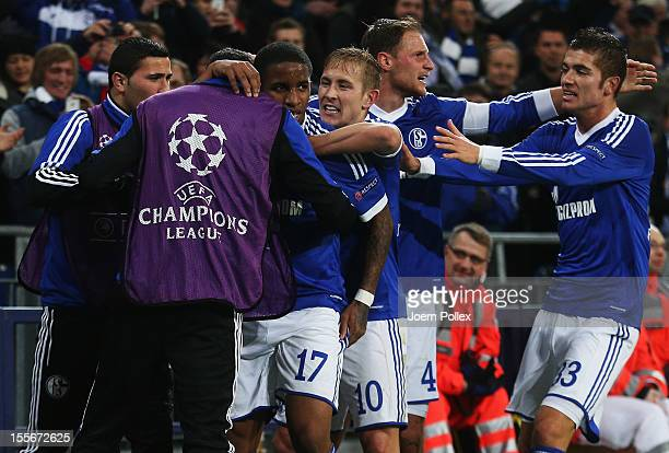 Jefferson Farfan of Schalke celebrates with his team mates after scoring his team's second goal during the UEFA Champions League group B match...