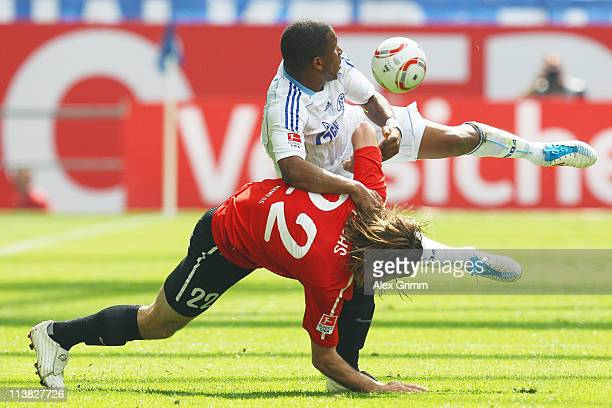 Jefferson Farfan of Schalke is challenged by Christian Fuchs of Mainz during the Bundesliga match between FC Schalke 04 and FSV Mainz 05 at Veltins...