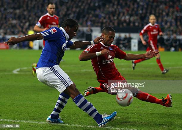 Jefferson Farfan of Schalke is challenged by Dennis Aogo of Hamburg during the Bundesliga match between FC Schalke 04 and Hamburger SV at Veltins...