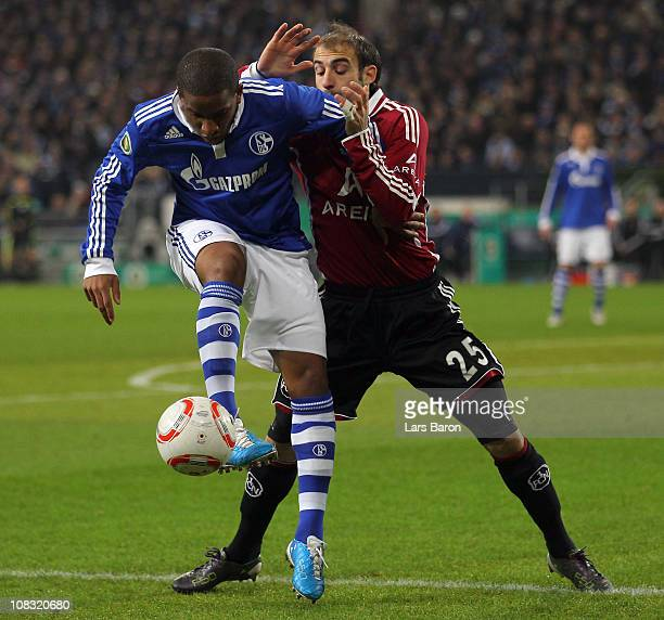 Jefferson Farfan of Schalke is challenged by Javier Pinola of Nuernberg during the DFB Cup quarter final match between FC Schalke 04 and 1 FC...