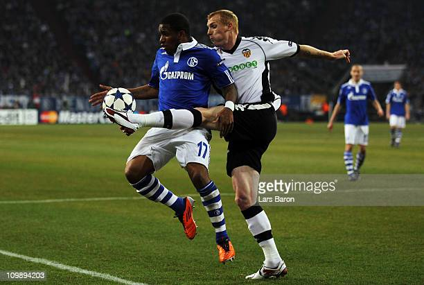 Jefferson Farfan of Schalke is challenged by Jeremy Mathieu of Valencia during the UEFA Champions League round of 16 second leg match between Schalke...