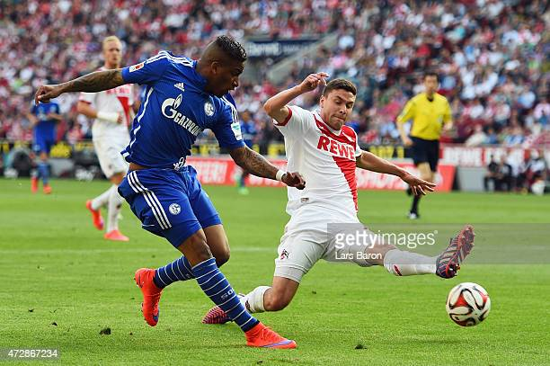 Jefferson Farfan of Schalke is challenged by Jonas Hector of Koeln during the Bundesliga match between 1 FC Koeln and FC Schalke 04 at...