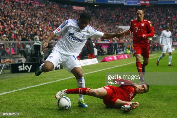 Jefferson Farfan of Schalke is challenged by Philipp Lahm of Muenchen during the Bundesliga match between FC Bayern Muenchen and FC Schalke 04 at...