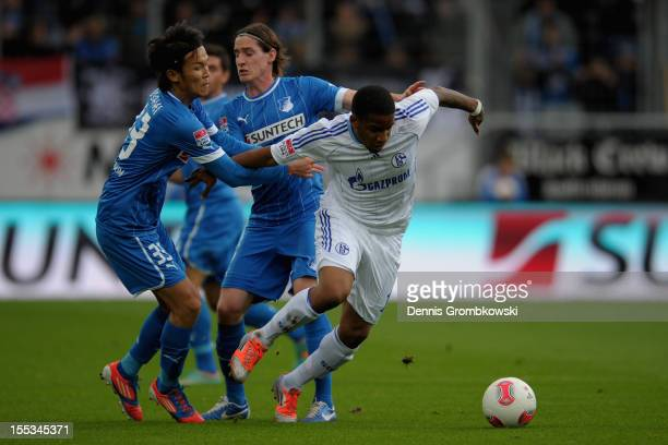 Jefferson Farfan of Schalke is challenged by Takashi Usami of Hoffenheim during the Bundesliga match between TSG 1899 Hoffenheim and FC Schalke 04 at...