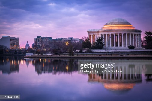 Jefferson Memorial with Capitol Dome at dawn
