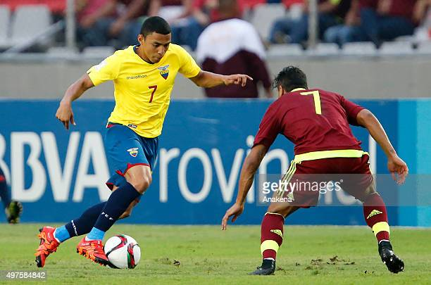 Jefferson Montero of Ecuador drives the ball as Jeffren Suarez of Venezuela tries to defend during a match between Venezuela and Ecuador as part of...