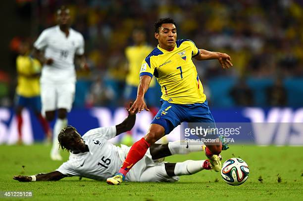 Jefferson Montero of Ecuador is tackled by Bacary Sagna of France during the 2014 FIFA World Cup Brazil Group E match between Ecuador and France at...