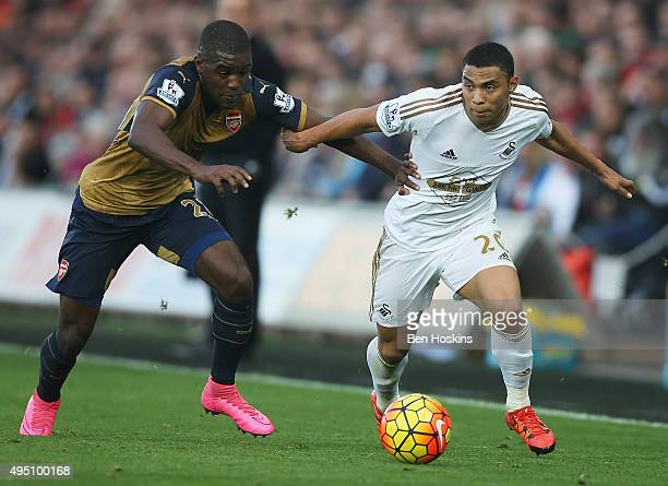 Jefferson Montero of Swansea City and Joel Campbell of Arsenal compete for the ball during the Barclays Premier League match between Swansea City and...