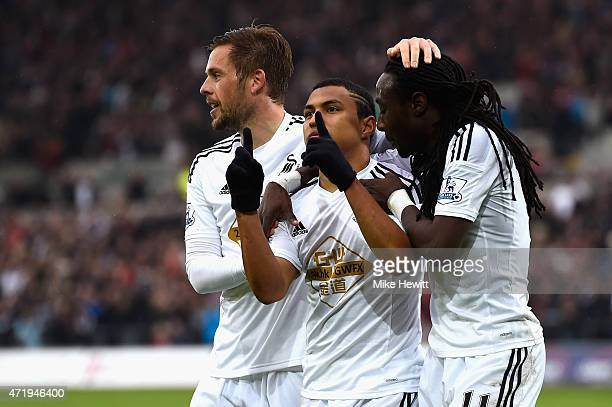 Jefferson Montero of Swansea City celebrates scoring his team's first goal with his team mates Gylfi Sigurdsson and Marvin Emnes during the Barclays...
