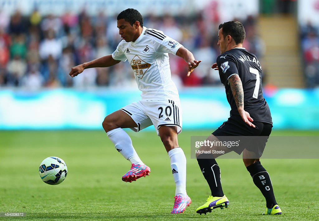<a gi-track='captionPersonalityLinkClicked' href=/galleries/search?phrase=Jefferson+Montero&family=editorial&specificpeople=4406087 ng-click='$event.stopPropagation()'>Jefferson Montero</a> of Swansea City holds off <a gi-track='captionPersonalityLinkClicked' href=/galleries/search?phrase=Ross+Wallace&family=editorial&specificpeople=800369 ng-click='$event.stopPropagation()'>Ross Wallace</a> of Burnley during the Barclays Premier League match between Swansea City and Burnley at Liberty Stadium on August 23, 2014 in Swansea, Wales.