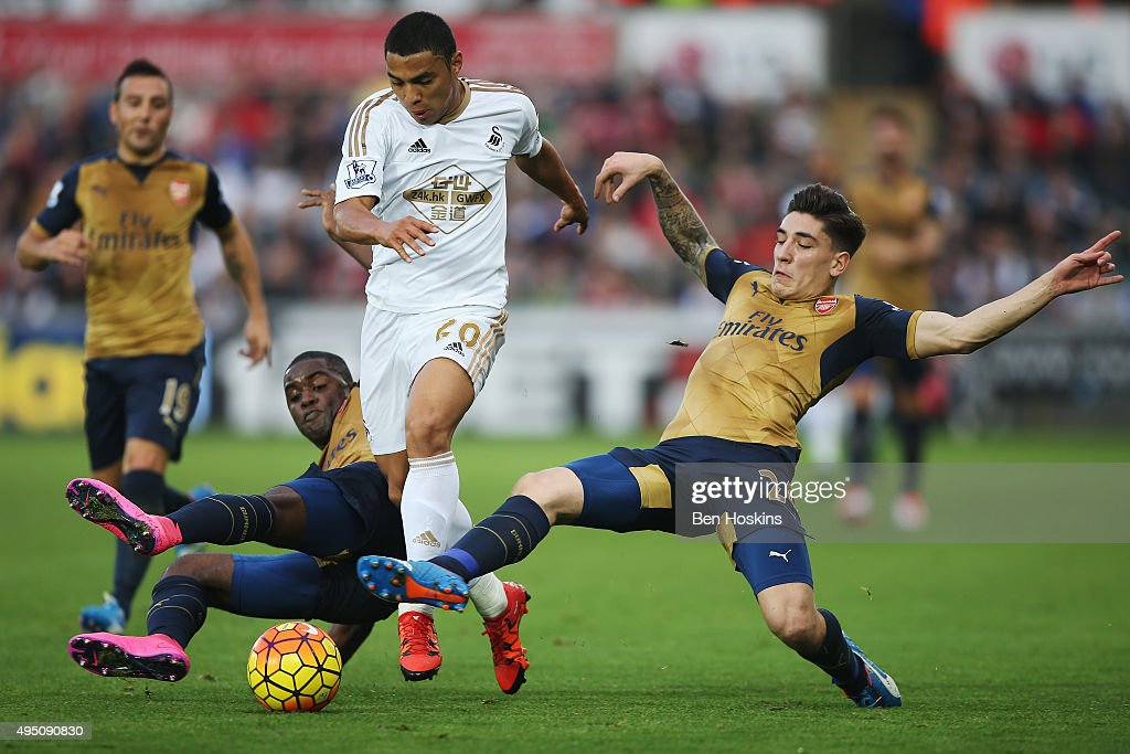 Jefferson Montero (C) of Swansea City vies for the ball with Joel Campbell (L) and Hector Bellerin (R) of Arsenal during the Barclays Premier League match between Swansea City and Arsenal at Liberty Stadium on October 31, 2015 in Swansea, Wales.