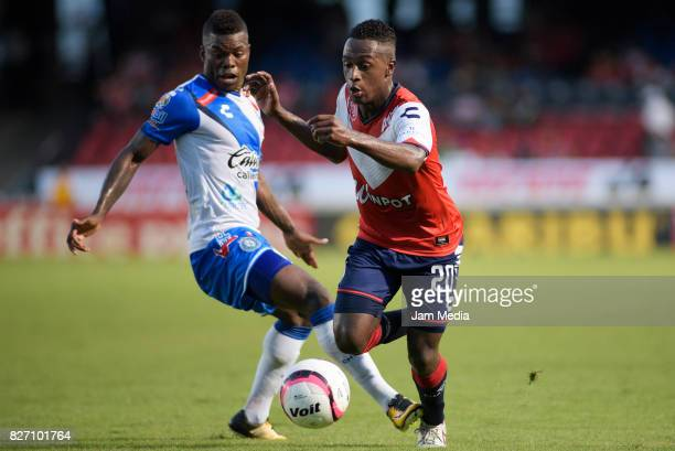 Jefferson Murillo of Veracruz and Félix Micolta of Puebla fight for the ball during the 3rd round match between Veracruz and Puebla as part of the...