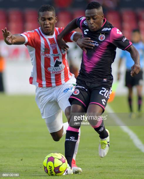 Jefferson Murillo of Veracruz fights for the ball with Bryan Beckeles of Necaxa during the 14th round match between Veracruz and Necaxa as part of...