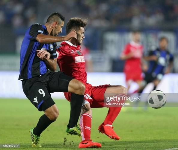 Jefferson of Latina competes for the ball with Luca Ceppitelli of Bari during the Serie B playoff match between US Latina and AS Bari at Stadio...
