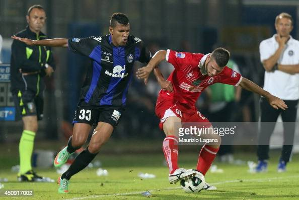 Jefferson of Latina competes for the ball with Stefano Sabelli of Bari during the Serie B playoff match between US Latina and AS Bari at Stadio...