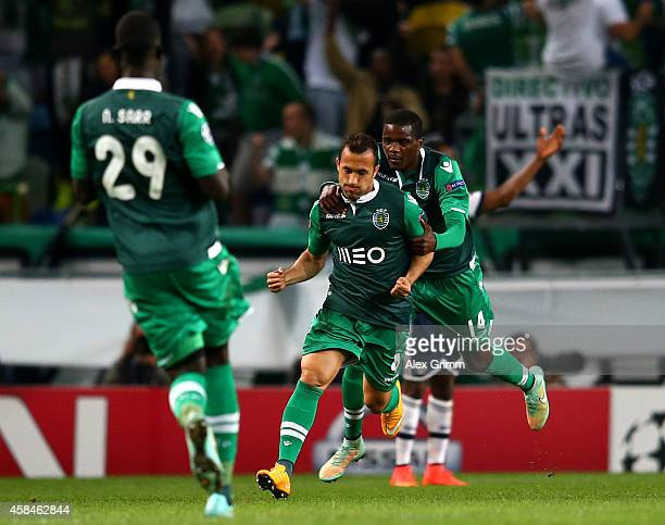 Jefferson of Sporting Lisbon celebrates scoring their second goal William Carvalho of Sporting Lisbon during the UEFA Champions League Group G match...