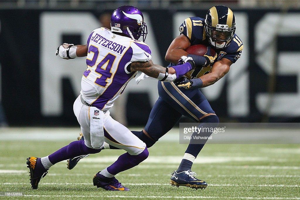 A.J. Jefferson #24 of the Minnesota Vikings attempts to tackle Brandon Gibson #11 of the St. Louis Rams at the Edward Jones Dome on December 16, 2012 in St. Louis, Missouri.