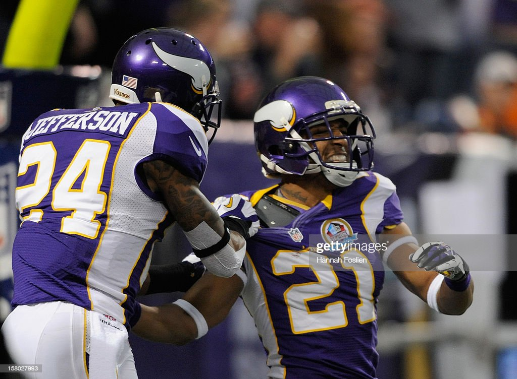 A.J. Jefferson #24 of the Minnesota Vikings congratulates Josh Robinson #21 on a interception during the first quarter of the game against the Chicago Bears on December 9, 2012 at Mall of America Field at the Hubert H. Humphrey Metrodome in Minneapolis, Minnesota.