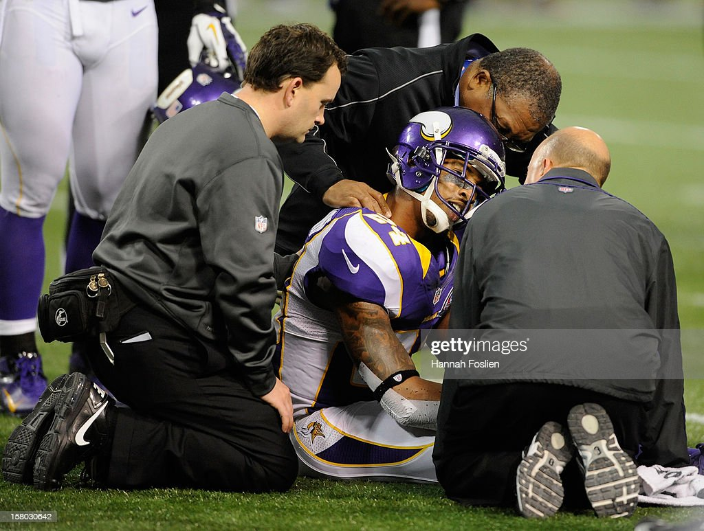A.J. Jefferson #24 of the Minnesota Vikings is checked on by players after being injured on a play during the fourth quarter of the game against the Chicago Bears on December 9, 2012 at Mall of America Field at the Hubert H. Humphrey Metrodome in Minneapolis, Minnesota. The Vikings defeated the Bears 21-14.