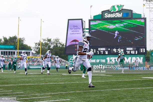J Jefferson of the Toronto Argonauts returns an interception the length of the field for a touchdown in the game between the Toronto Argonauts and...