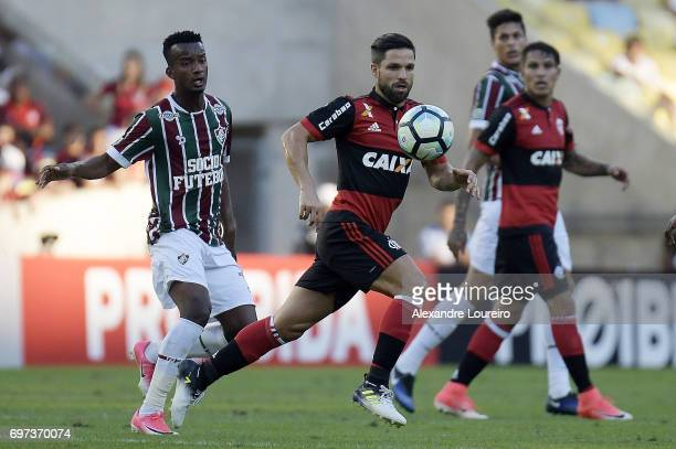 Jefferson Orejuela of Fluminense battles for the ball with Diego of Flamengo during the match between Fluminense and Flamengo as part of Brasileirao...