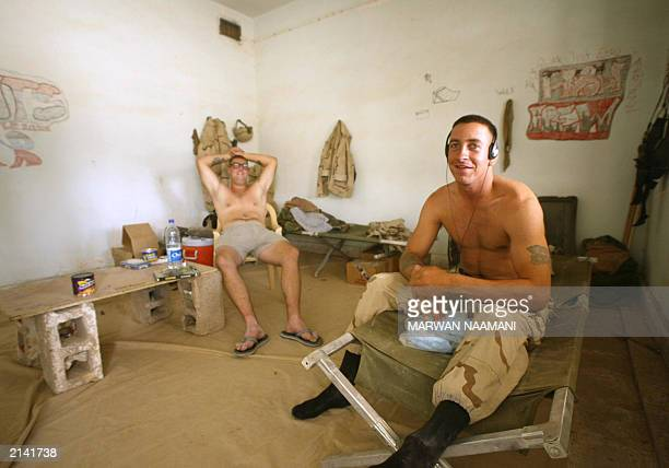 Jeffery R Hittle of Flint Mich and PFC Jeremy Wolfsteller from Minneapolis Minn both of the 2nd Squadron 3rd armourned cavalry regiment relax in at...