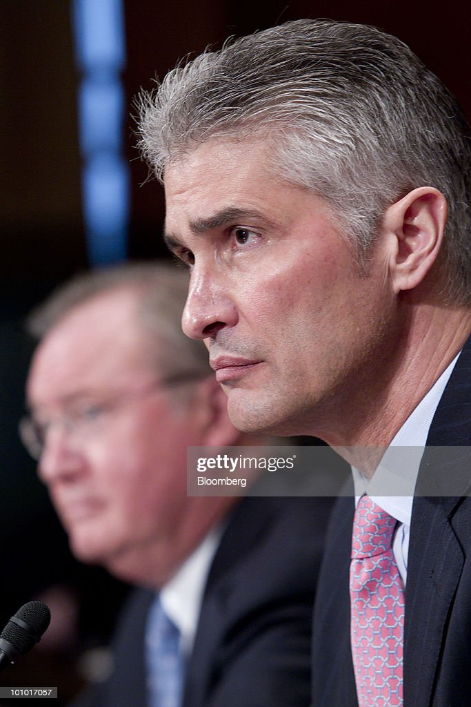 Jeffery Smisek, chairman, president and chief executive officer of Continental Airlines Inc., right, and Glenn Tilton, chairman, president and chief executive officer of United Airlines, listen during an Antitrust, Competition Policy and Consumer Rights Subcommittee hearing on the proposed merger between United Airlines and Continental Airlines Inc. in Washington, D.C., U.S., on Thursday, May 27, 2010. United Airlines' proposed merger with Continental Airlines won't cut competition because discount carriers can begin service and win passengers, the chief executives of the two companies told a Senate antitrust panel. Photographer: Andrew Harrer/Bloomberg via Getty Images