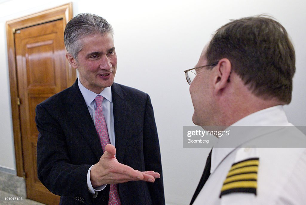 Jeffery Smisek, chairman, president and chief executive officer of Continental Airlines Inc., speaks to Ben Berman, pilot with Continental Airlines Inc., following an Antitrust, Competition Policy and Consumer Rights Subcommittee hearing on the proposed merger between United Airlines and Continental Airlines Inc. in Washington, D.C., U.S., on Thursday, May 27, 2010. United Airlines' proposed merger with Continental Airlines won't cut competition because discount carriers can begin service and win passengers, the chief executives of the two companies told a Senate antitrust panel. Photographer: Andrew Harrer/Bloomberg via Getty Images