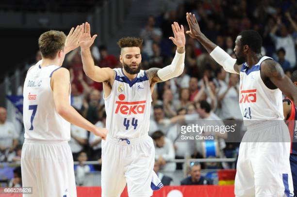 Jeffery Taylor #44 forward of Real Madrid and Luka Doncic #7 guard of Real Madrid and Othello Hunter #21 center of Real Madrid during the Liga Endesa...