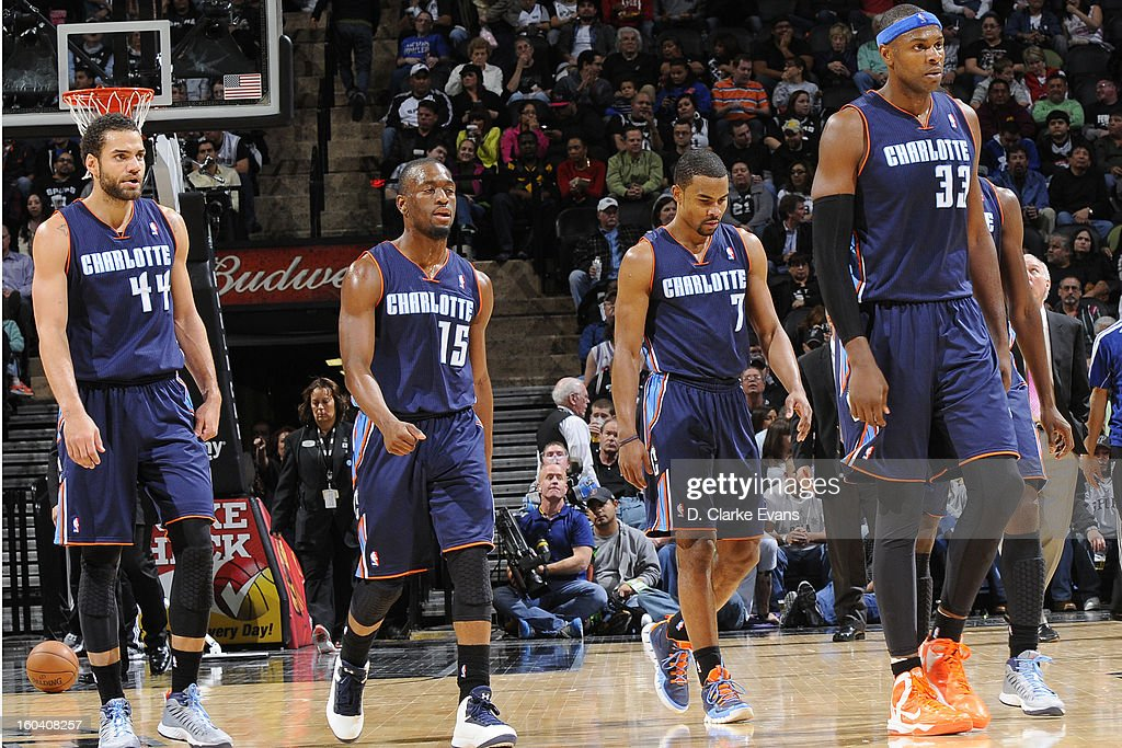 Jeffery Taylor #44 , Kemba Walker #15 , Ramon Sessions #7 and Brendan Haywood #33 of the Charlotte Bobcats walk back to their bench after a time out was taken against the San Antonio Spurs on January 30, 2013 at the AT&T Center in San Antonio, Texas.