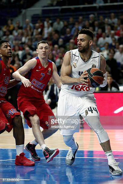 Jeffery Taylor of Real Madrid vies for the ball against Vitaliy Fridzon of CSKA Moscow during the Turkish Airlines Euroleague Basketball match...