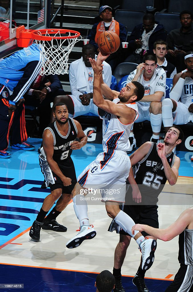 Jeffery Taylor #44 of the Charlotte Bobcats drives to the basket against the San Antonio Spurs at Time Warner Cable Arena on December 8, 2012 in Charlotte, North Carolina.
