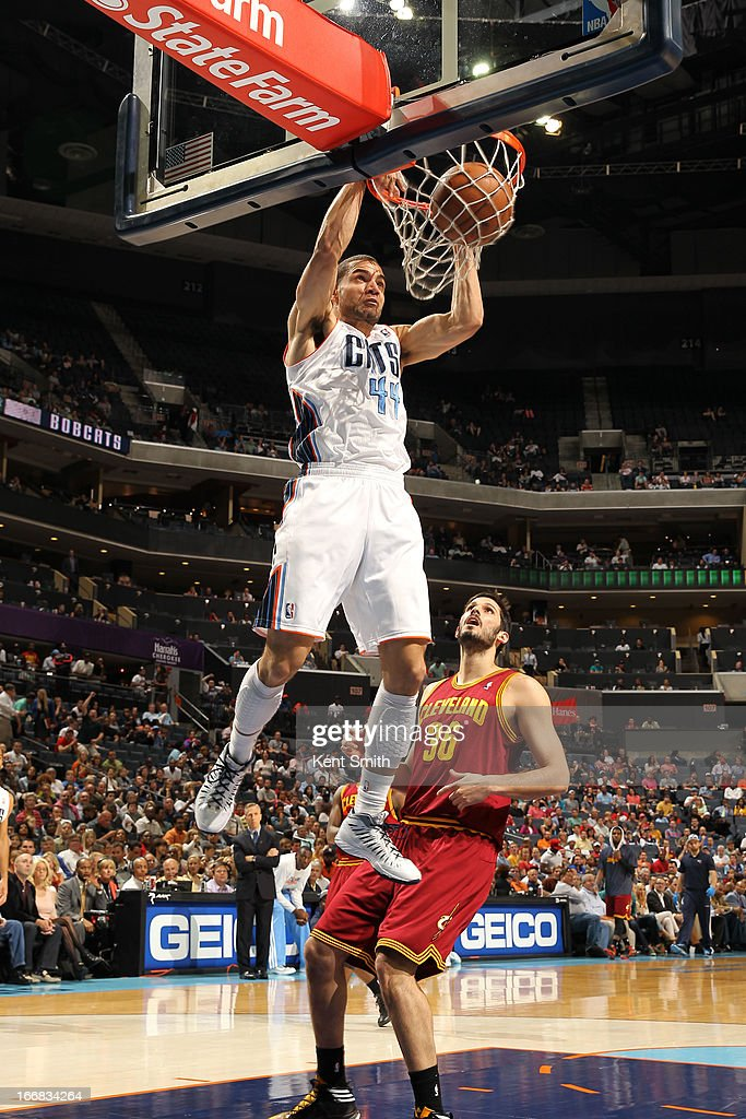 Jeffery Taylor #44 of the Charlotte Bobcats dunks against Omri Casspi #36 of the Cleveland Cavaliers at the Time Warner Cable Arena on April 17, 2013 in Charlotte, North Carolina.