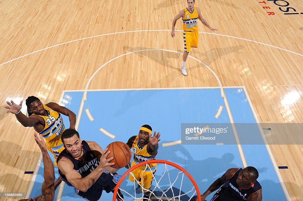 Jeffery Taylor #44 of the Charlotte Bobcats goes to the basket against <a gi-track='captionPersonalityLinkClicked' href=/galleries/search?phrase=Kenneth+Faried&family=editorial&specificpeople=5765135 ng-click='$event.stopPropagation()'>Kenneth Faried</a> #35 and <a gi-track='captionPersonalityLinkClicked' href=/galleries/search?phrase=Ty+Lawson&family=editorial&specificpeople=4024882 ng-click='$event.stopPropagation()'>Ty Lawson</a> #3 of the Denver Nuggets on December 22, 2012 at the Pepsi Center in Denver, Colorado.