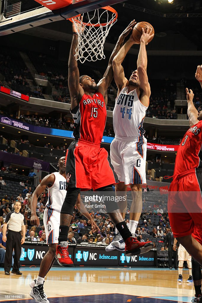 Jeffery Taylor #44 of the Charlotte Bobcats goes up for a dunk against Amir Johnson #15 of the Toronto Raptors at the Time Warner Cable Arena on March 20, 2013 in Charlotte, North Carolina.