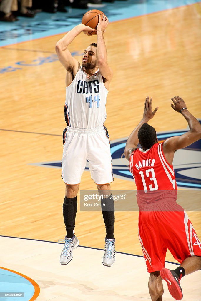 Jeffery Taylor #44 of the Charlotte Bobcats shoots against James Harden #13 of the Houston Rockets at the Time Warner Cable Arena on January 21, 2013 in Charlotte, North Carolina.